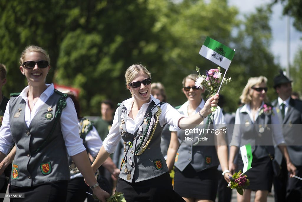 Participants smile to the crowd during a parade at the world's largest shooting fair, known as Schutzenfest, on July 6, 2014 in Hanover, Germany. A Schutzenfest, or German 'Marksmen's Festival' is a traditional festival featuring a target shooting competition in the cultures of both Germany and Switzerland. Reports indicate that more than a million visitors are expected to attend the 2014 Marksmen's Festival.