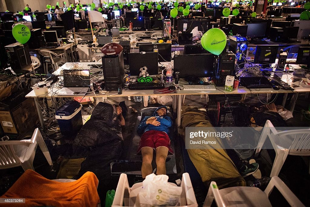 Participants spleep after spending the night at the LAN area during the DreamHack Valencia 2014 on July 19, 2014 in Valencia, Spain. Dreamhack Valencia is one of the European stops from the Dreamhack World Tour, the world's largest LAN party and computer festival. This year 3,000 devices will be connected to the Dreamhack Valencia network during 96 hours non-stop.