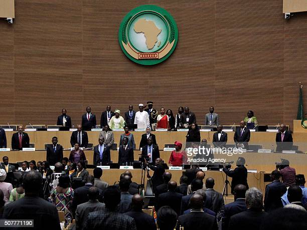 Participants stand in one minute's silence during the closing session within the 26th African Union Summit in Addis Ababa Ethiopia on January 31 2016