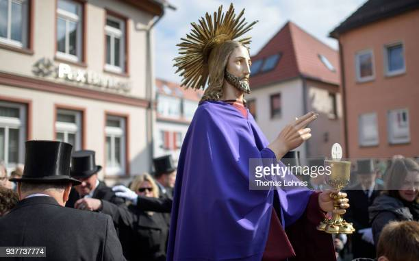 Participants stand next to an effigy of Jesus Christ during the annual Palm Sunday procession on March 25 2018 in Heiligenstadt Germany The annual...