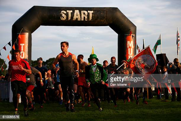 Participants start the 2016 Tough Mudder London South at Holmbush Farm on September 24 2016 in Horsham England