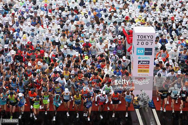 Participants start the Tokyo Marathon 2007 on February 18 2007 in Tokyo Japan Some 30000 people participated in the marathon through Tokyo past many...