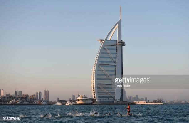 Participants swim past Burj Al Arab during the Ironman 703 Dubai 2018 on February 2 2018 in Dubai United Arab Emirates