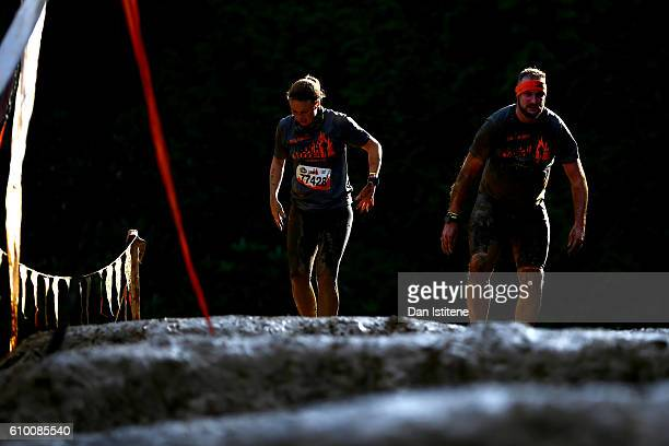 Participants tackle the Mud Mile during the 2016 Tough Mudder London South at Holmbush Farm on September 24 2016 in Horsham England