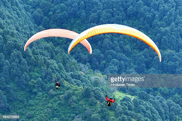 Participants take a part in the AAI Paragliding World Cup 2015 at Bir near Palampur on October 24 2015 in Dharamsala India A total of 130 pilots...