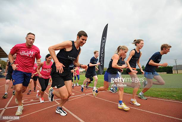 Participants take off during interval training during the Laureus Oxford Half Marathon Training Day at the Roger Bannister Athletics Track on...