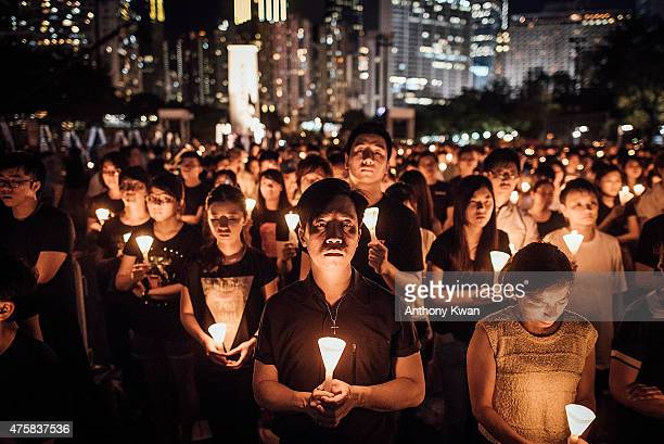 Participants take part at the candlelight vigil as they hold candles at Victoria Park on June 4, 2015 in Causeway Bay, Hong Kong. Hong Kong residents...