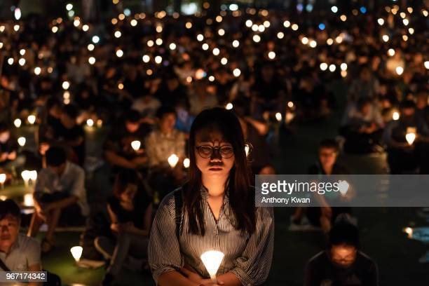 Participants take part at the candlelight vigil at Victoria Park on June 4 2018 in Hong Kong Thousands of people participated in an annual...