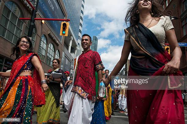 Participants take part at the Hare Krishna Parade 2016 in Toronto Canada on July 16 2016 The festival organized by the Toronto chapter of the...