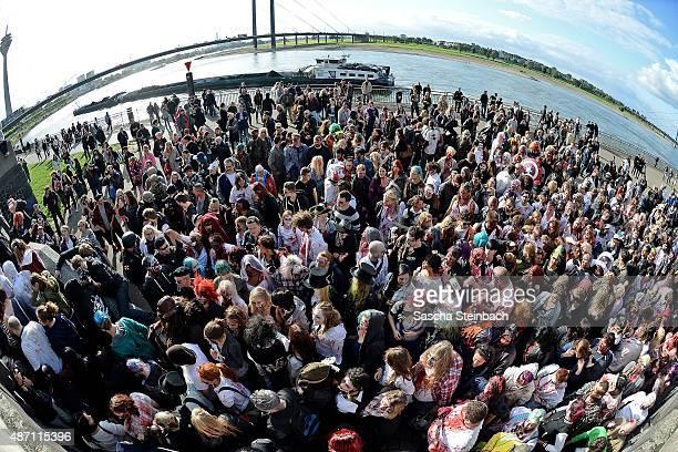 Participants take part at the Zombie Walk Duesseldorf along the Rheinuferpromenade on September 6, 2015 in Duesseldorf, Germany. A zombie walk is an...