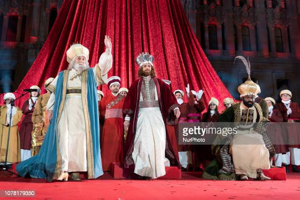 Participants take part during a parade in Madrid The traditional Three Kings parade is held all over the country 05 January every year before...
