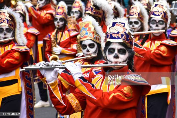 Participants take part during the commemorative 'Day of the Dead International Parade' as part of celebrations of the mexican traditions Day of the...