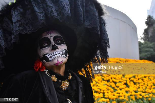 Participants take part during The Mega parade of Catrinas as part of celebration of Mexican tradition Day of the Dead Dia de Muertos at Reforma...