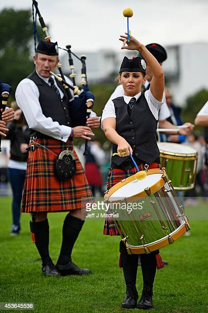 Participants take part in 2014 World Pipe Band Championships grade one qualifiers at Glasgow Green on August 15 2014 in Glasgow Scotland The annual...