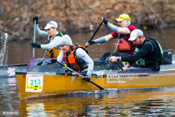 Participants take part in 36th Run of the Charles paddle race along the Charles River in Dedham MA on April 29 2018