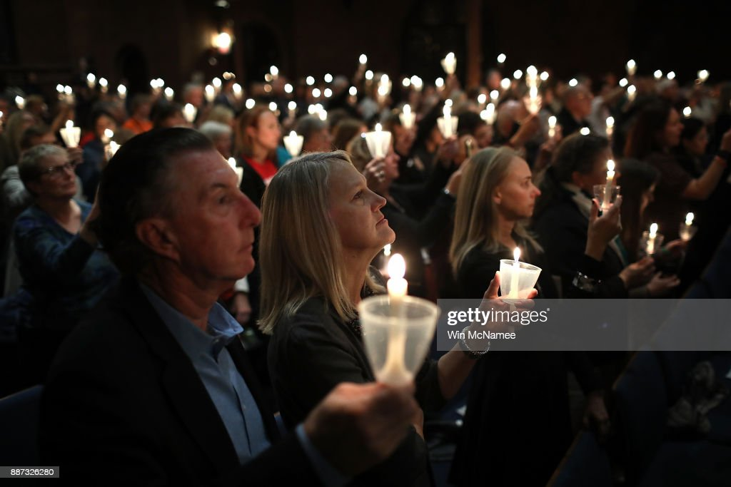 Participants take part in a candlelight vigil as part of the 5th annual National Vigil For Gun Violence Victims at St. Mark's Episcopal Church December 6, 2017 in Washington, DC. The event, held by the Newtown Foundation, is held nationally for the victims, survivors and families impacted by gun violence in the U