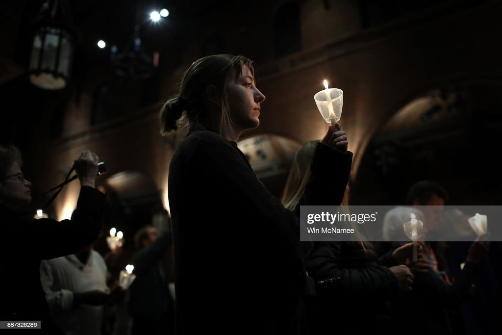 Participants take part in a candlelight vigil as part of the 5th annual National Vigil For Gun Violence Victims at St. Mark's Episcopal Church December 6, 2017 in Washington, DC. The event, held by the Newtown Foundation, is held nationally for the victims, survivors and families impacted by gun violence in the U.S.