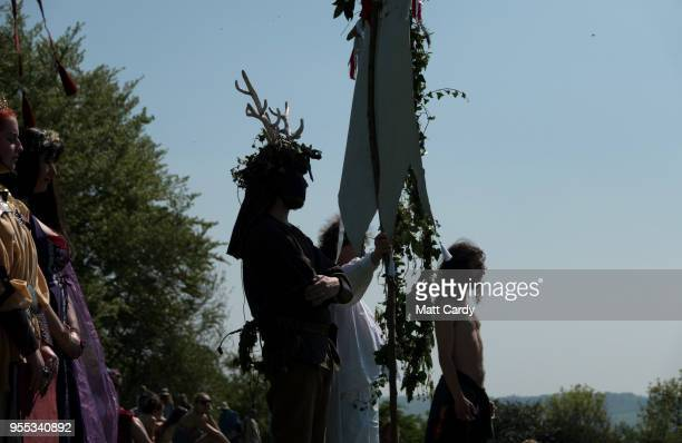 Participants take part in a ceremony below Glastonbury Tor as they take part in May Fayre and Dragon Procession in Glastonbury on May 6 2018 in...