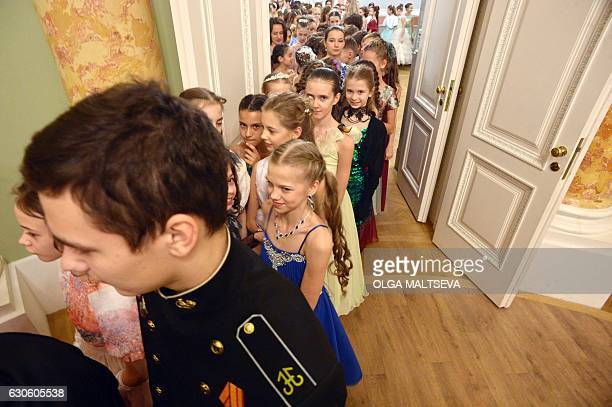 Participants take part in a Christmas ball in Saint Petersburg, on December 27, 2016. Cadets of the Naval Academy and of the Suvorov Military School...