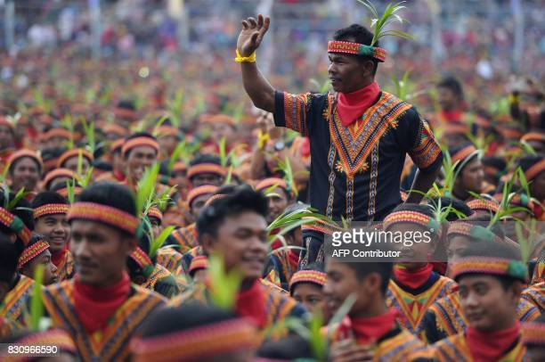 Participants take part in a mass traditional Saman dance performance in the Gayo Lues highland district in Aceh on Indonesia's Sumatra island on...
