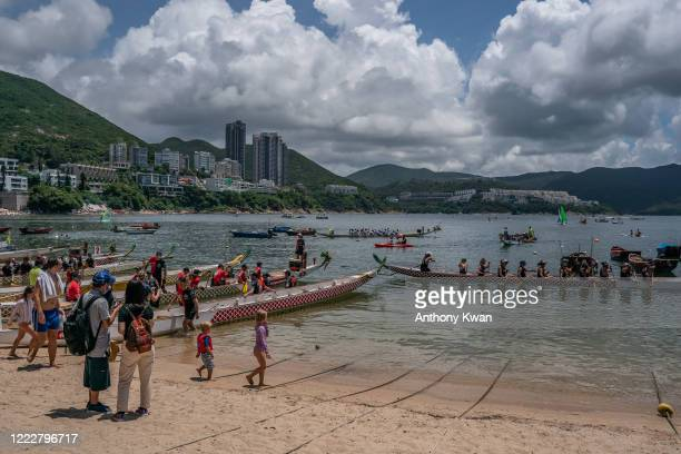 Participants take part in a practice run during the Dragon Boat Festival on June 25, 2020 in Hong Kong, China. The annual Dragon Boat Festival has...