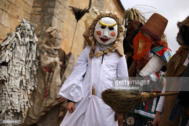 Participants take part in El Gallo de Carnaval in Mecerreyes in the northern Spanish province of Burgos on February 7 2016 The Gallo Carnival is a...