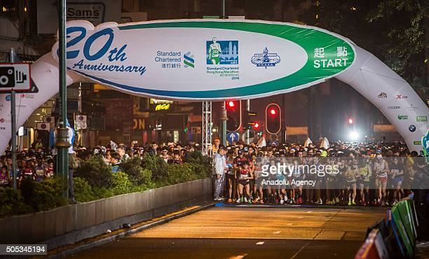 Participants take part in the 20th Standard Chartered Hong Kong Marathon on January 17 2015 The Standard Chartered Hong Kong Marathon is Hong Kong's...