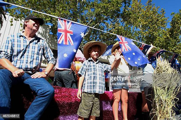 Participants take part in the 43rd Tamworth Country Music Festival Calvalcade along Peel Street on January 24 2015 in Tamworth Australia Over 80...