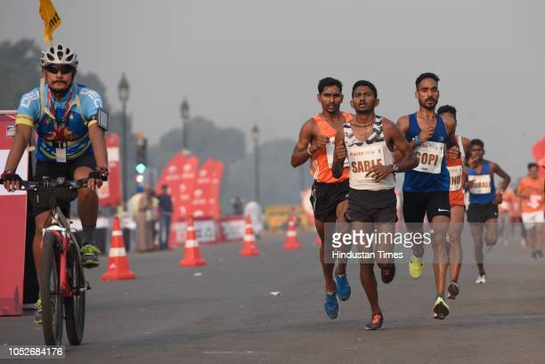 Participants take part in the Airtel Delhi Half Marathon at Rajpath on October 21 2018 in New Delhi India Over 34000 marathoners are participating in...