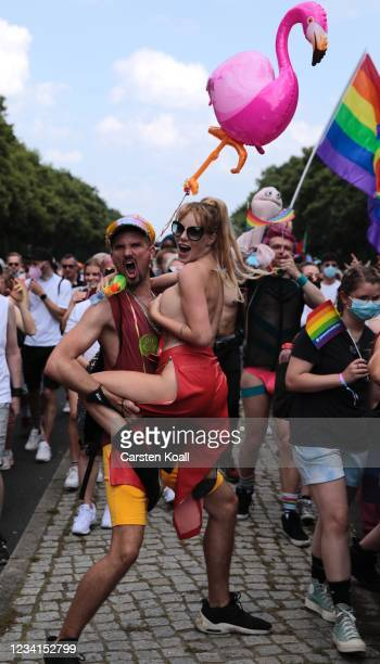 Participants take part in the annual Christopher Street Day parade on July 24, 2021 in Berlin, Germany. The Christopher Street Day parade is held in...