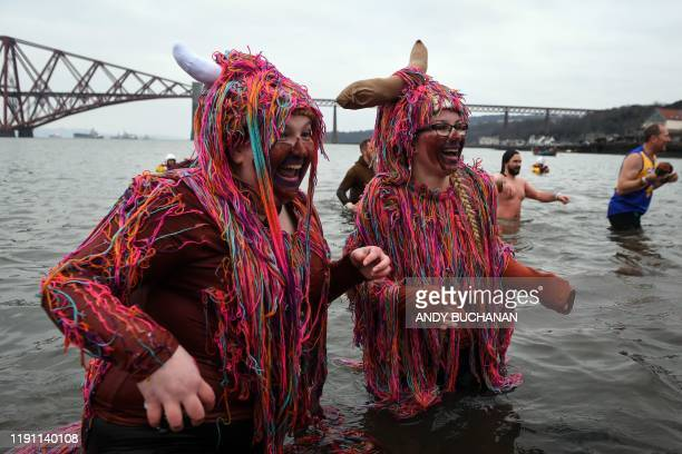 Participants take part in the annual New Year's Day Loony Dook swim in the Firth of Forth in South Queensferry near Edinburgh on January 1 2020 Every...
