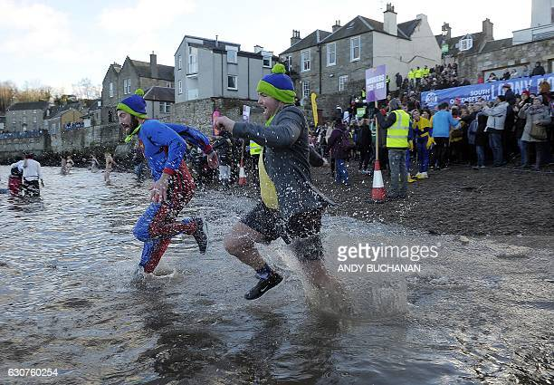 Participants take part in the annual New Year's Day 'Loony Dook' swim in the Firth of Forth in South Queensferry near Edinburgh on January 1 2017...