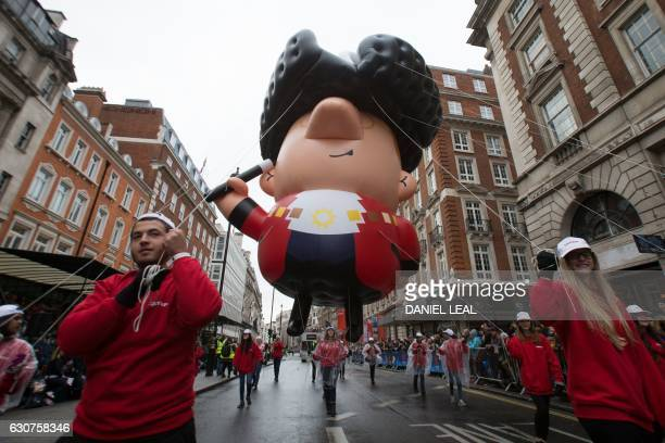 Participants take part in the annual New Year's Day Parade in central London on January 1 2017 / AFP / Daniel LEALOLIVAS