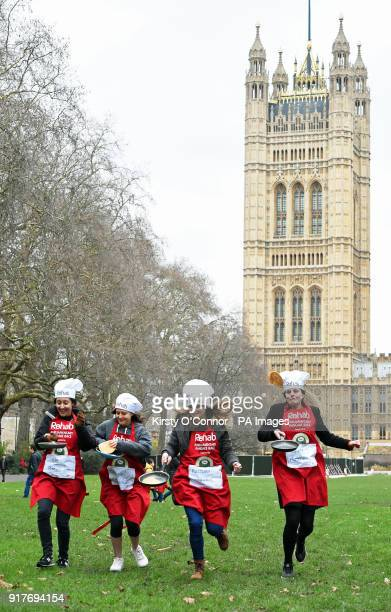 Participants take part in the annual Parliamentary Pancake Race featuring teams of MPs Lords and political journalists in aid of the Rehab disability...