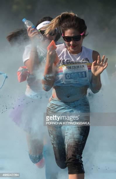 Participants take part in the Color Run at Suan Rod Fai park in Bangkok on October 31 2015 The Color Run is a five kilometer fun run that started in...