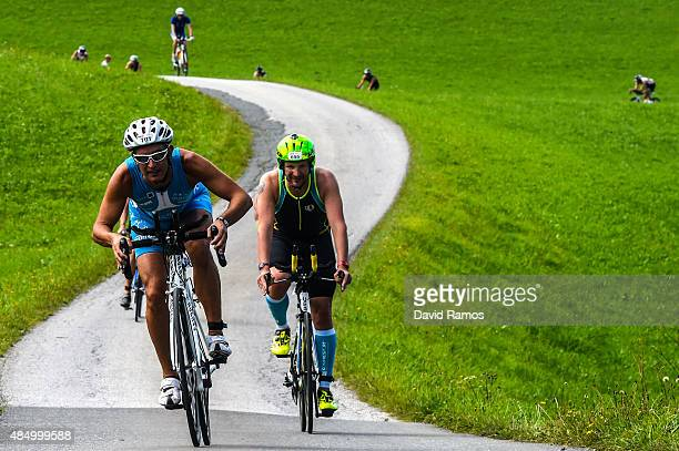 Participants take part in the cycle leg of the race during the Challenge Triathlon WalchseeKaiserwinkl on August 23 2015 in Walchsee Austria
