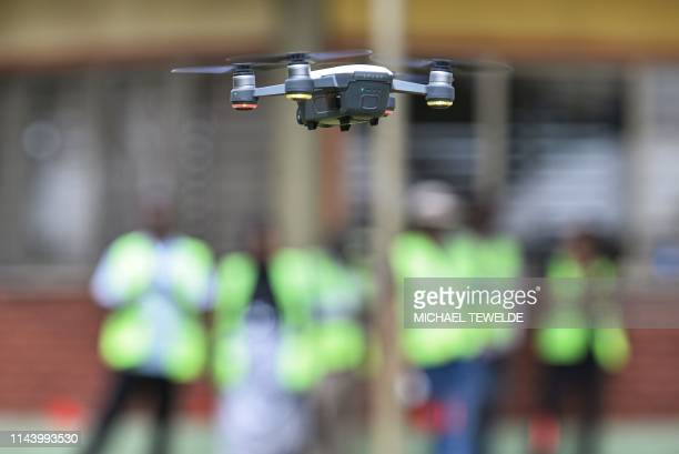 Participants take part in the first drone flight training by the World Food Programme for humanitarian and development work in Ethiopia on May 15 in...
