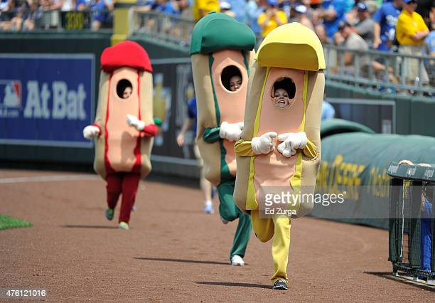 Participants take part in the Hot Dog Derby Run during a game between Texas Rangers Kansas City Royals in the fifth inning at Kauffman Stadium on...