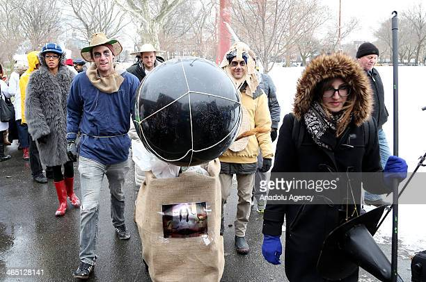 Participants take part in the 'Iditarod Race' held for the 10th time this year on January 25 2014 in New York United States in reaction to the...