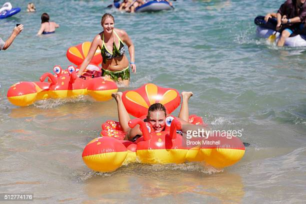 Participants take part in the Manly Inflatable Boat Race on February 28 2016 in Manly Australia The annual event requires racers to compete in an...