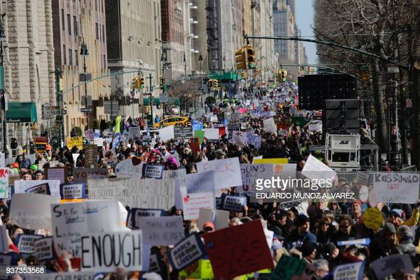 Participants take part in the March for Our Lives Rally near Central Park West in New York on March 24 2018 Bundled against the cold but fired up...