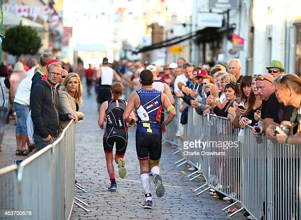 Participants take part in the running leg of the race during Ironman Kalmar on August 16 2014 in Kalmar Sweden