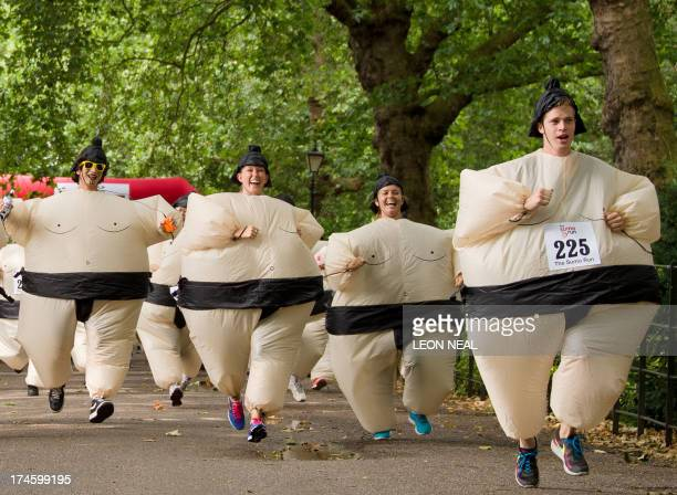 Participants take part in The Sumo Run in Battesea Park west London on July 28 2013 The Sumo Run is an annual 5km charity fun run around the park in...