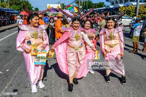 Participants take part in the traditional parade before the annual Chonburi Buffalo Race in Chonburi on October 1, 2020.