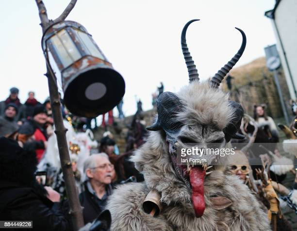 Participants take part in the Whitby Krampus parade on December 2 2017 in Whitby England The Krampus is a horned anthropomorphic figure from...