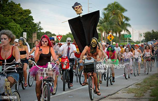 Participants take part in the zombie bike ride on the A1A next to the Atlantic Ocean on October 20 2013 in Key West Florida Thousands of costumed...
