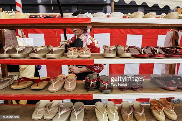 Participants take their 'Setta' leathersoled sandals off before shooting during an archery event for 20yearolds to celebrate their comingofage at...