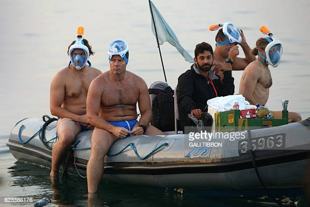 Participants taking part in a 17kilometre swim from Jordan to Israel across the Dead Sea organised by the EcoPeace charity aimed at raising awareness...