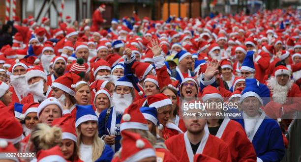 Participants taking part in the Liverpool Santa Dash in Liverpool