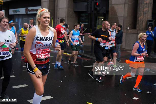 Participants taking part in the London Marathon running some four miles to go to complete the race on 23rd April 2017 in London England United Kingdom